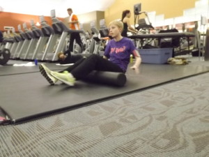 Jill works out with specific stretches that help improve her Scoliosis.
