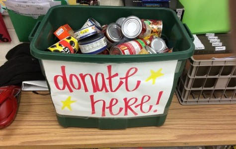 Cooking classes collecting food drive donations