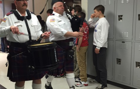 Bagpipe march celebrates Charity Bash total