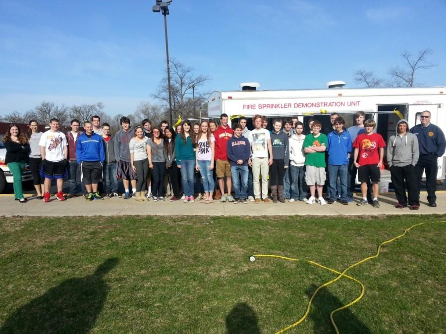 Lake Zurich Fire Department demonstrates fire sprinkler for science students