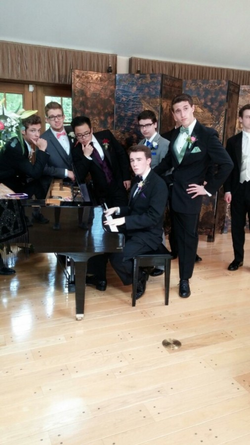 Gallagher poses on the piano [center] with Dever [right] and other friends at prom.