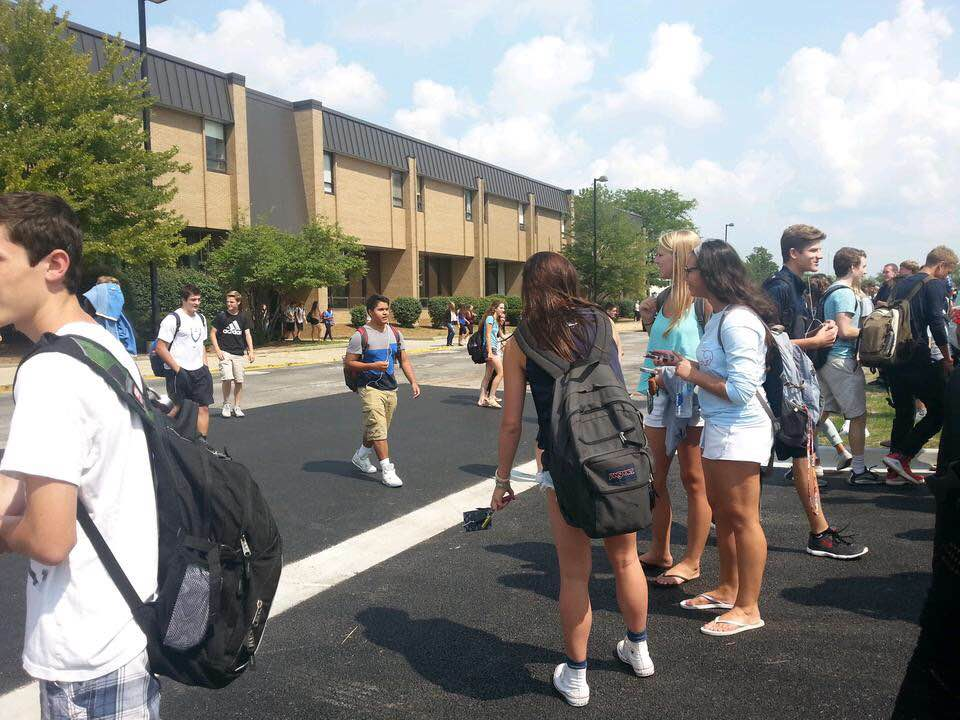 Lake Zurich students wait outside for the 'all clear' to go back into the building.  On Friday, the school will be practicing  all three drills.