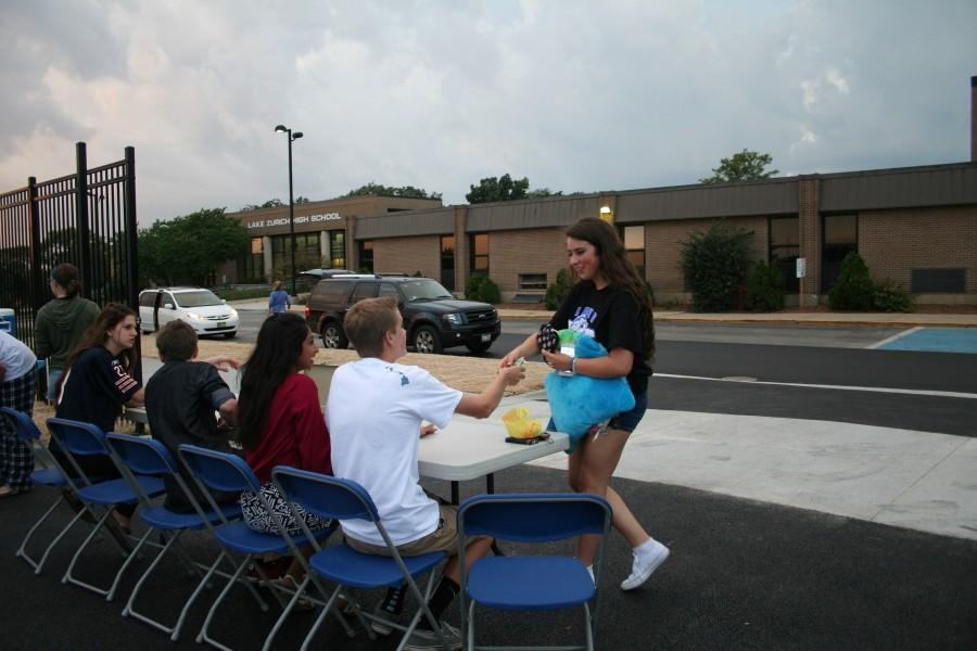 Students came to the football field expecting an ordinary movie night, but also got to share a sense of communion while waiting out the storm with peers.