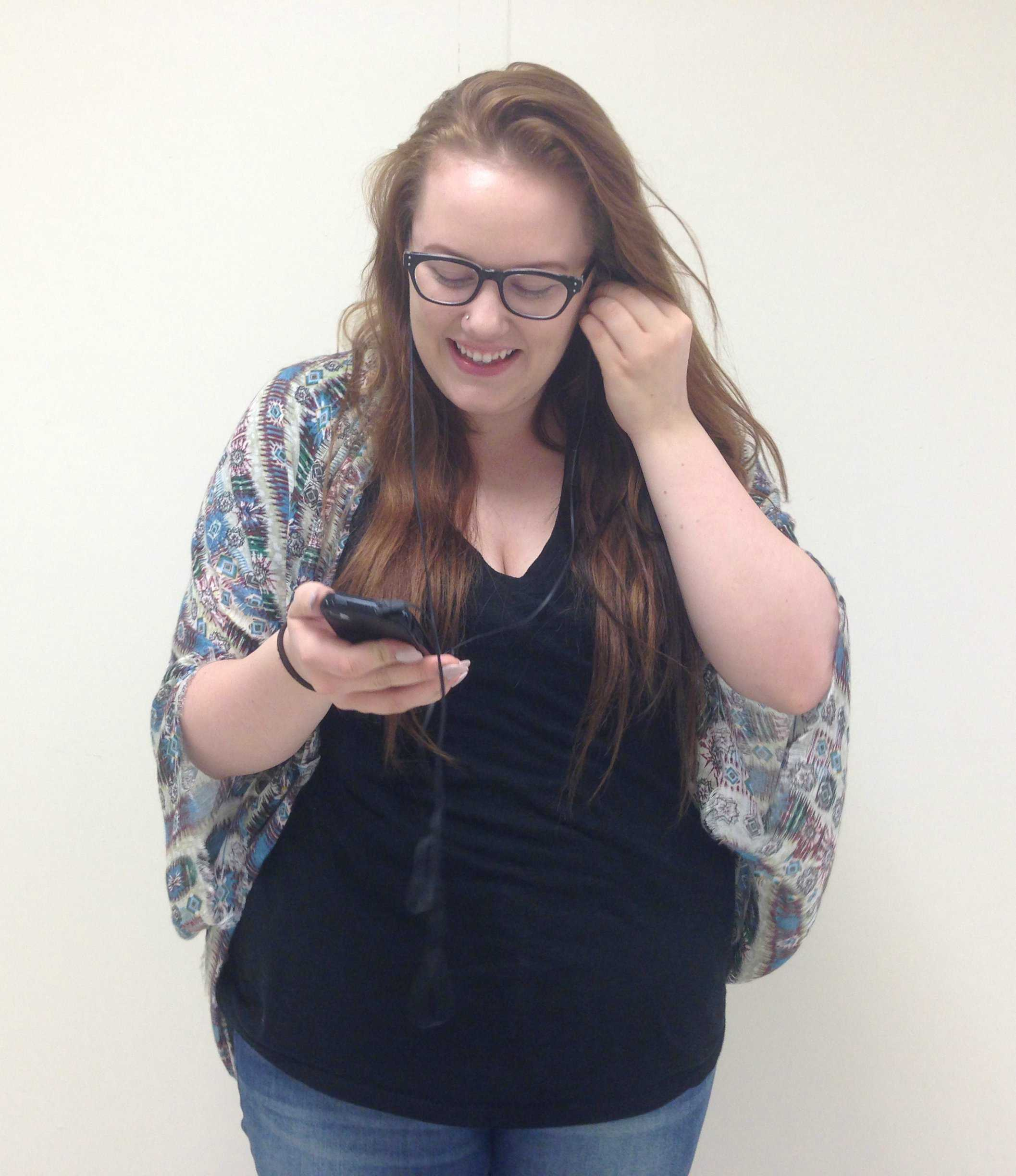 Brooke Branksy listens to her favorite music that she wishes to discuss within this new club.