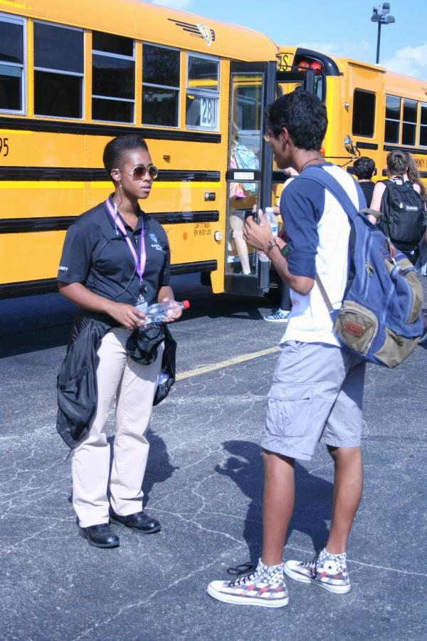 Val Redmond interacts with a student after school at bus duty. (goes to picture with Val and student by bus)