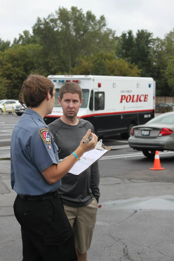 The Police Explorer post helped people set up car seats for a community service project. While learning about careers in law enforcement, the explorers often do things to help the community.