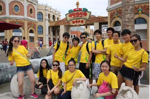 Alex Li, who has been teaching for Fenghua Academy for two years, is pictured with his volunteer group, who taught English to people in China.
