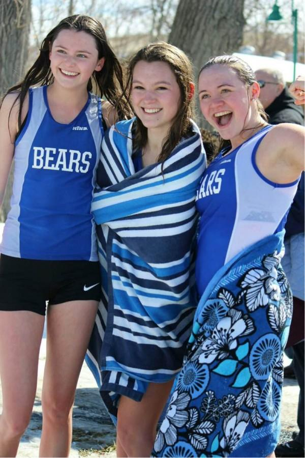 Kiersten McDevitt, Vada Murray, and Natalie Ullman, juniors, pose after running into Lake Zurich. The Girls Track and Field team has been participating in the Purple Plunge, a fundraiser that is run by the American Cancer Society, for many years.