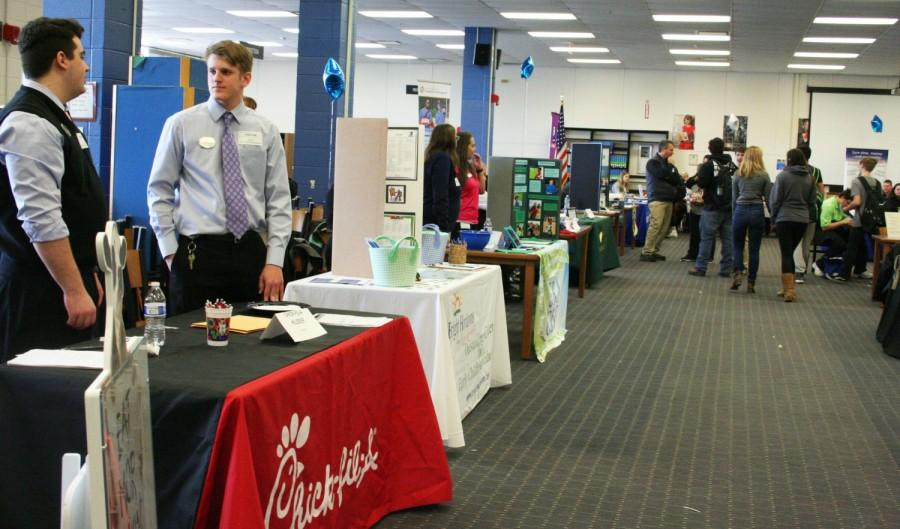 Students visit potential employers  at the annual job fair.
