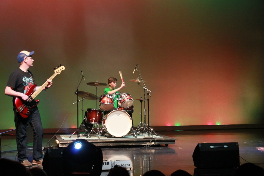 Anthony Powles, junior, plays at Battle of the Bands 2016 with the Jimmy Carter Rabbit Incident. He has been playing for four years, starting on buckets and moving to the drums.
