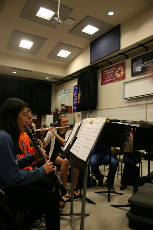 Band members in the Wind Ensemble practice their songs during sixth period. To prepare for the district band festival, students rehearse the songs they have been learning all year, along with extra songs that all district band members will perform together.