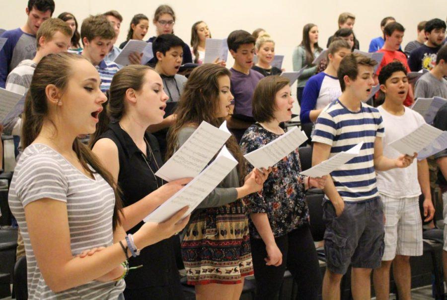 Concert choir practices for their upcoming concert on Wednesday, May 11.
