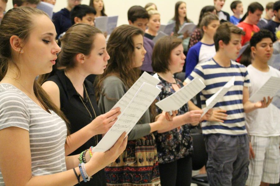 Choir students practice for their final bows of the year. They work on choreography and polishing the vocals as the concert date quickly approaches.