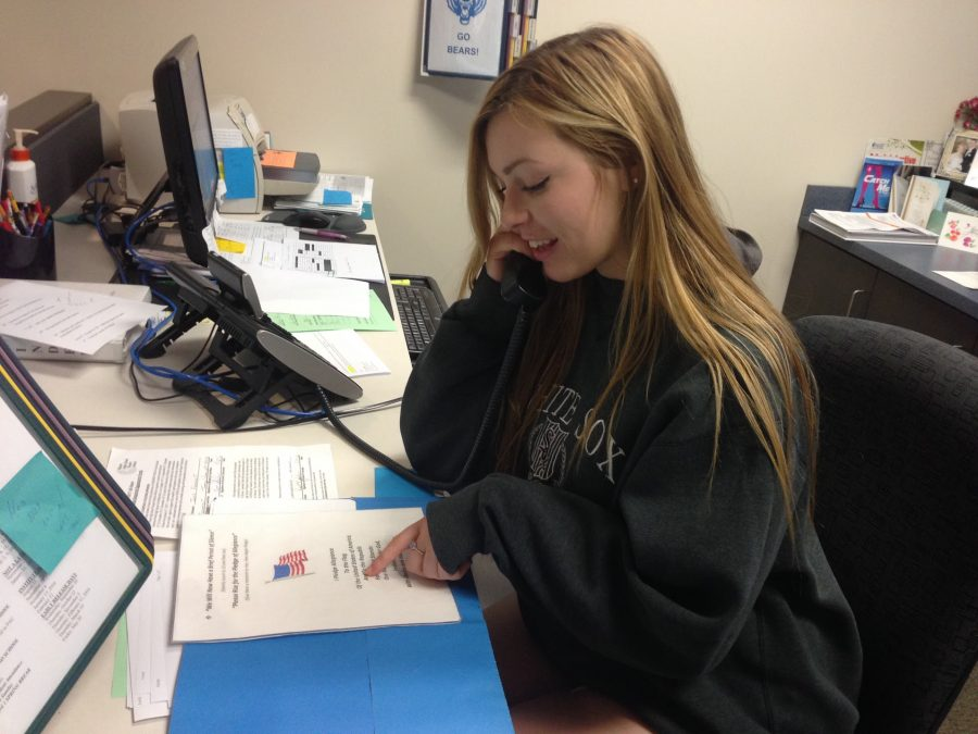 Amanda Sarsha, senior, recites the morning announcements for the school during first period. Sarsha and two other NHS students have three week rotations of the job.