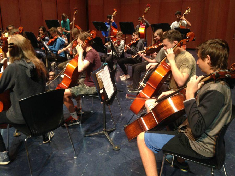 Orchestra members from first period  rehearse in the PAC. Students will take a break from practice, but still gain a lesson by watching the Chicago symphony rehearse on May 18