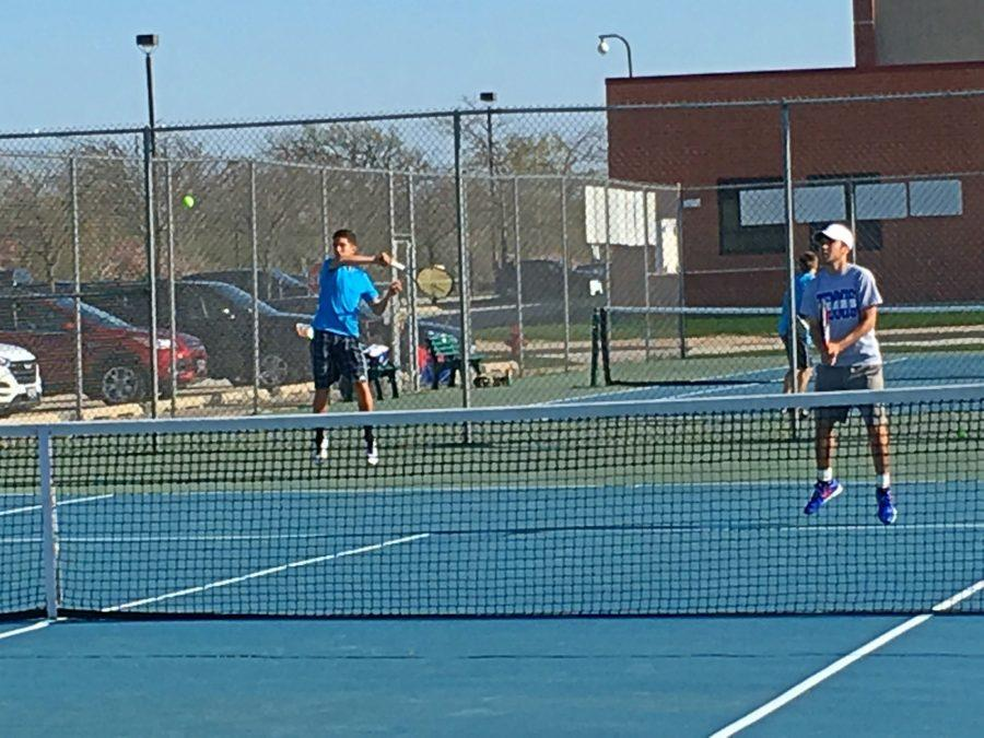 Roberto Guagnelli, junior in blue, has been playing tennis since he was about 10. Since then, he has played at the top of the school's varsity tennis lineup for two years, and was in the top 80 in the midwest for USTA last year.