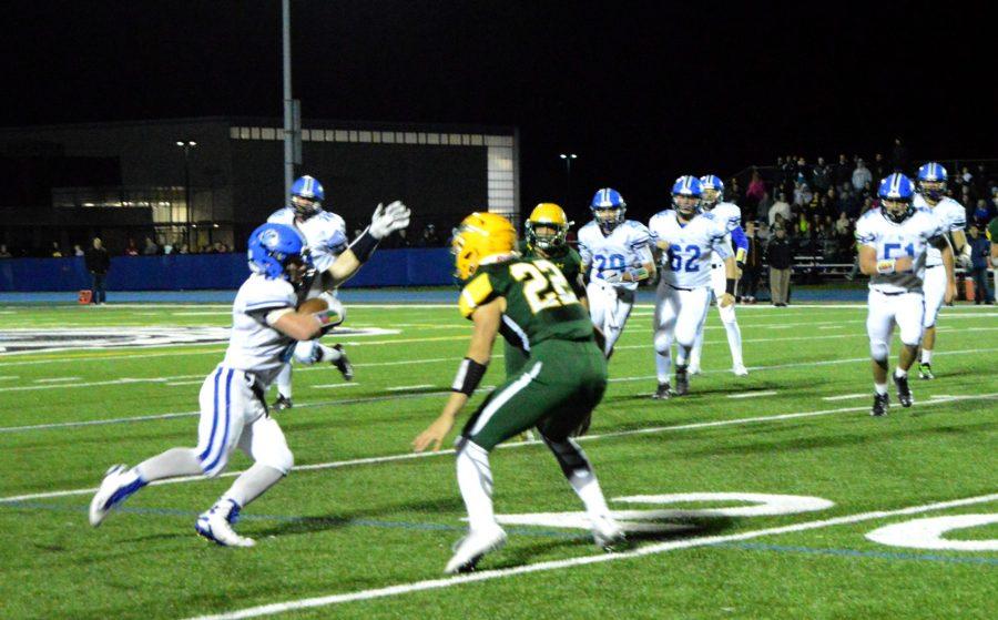 Joey Stutzman, junior linebacker, tries to outrun The Patriots' defense.