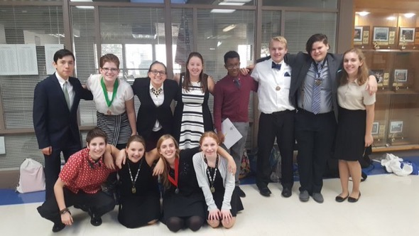 The Speech and Acting Team pose for a group photo after a competition. The team has been doing the best they've ever done this year, with multiple people placing at every competition the team have participated in.
