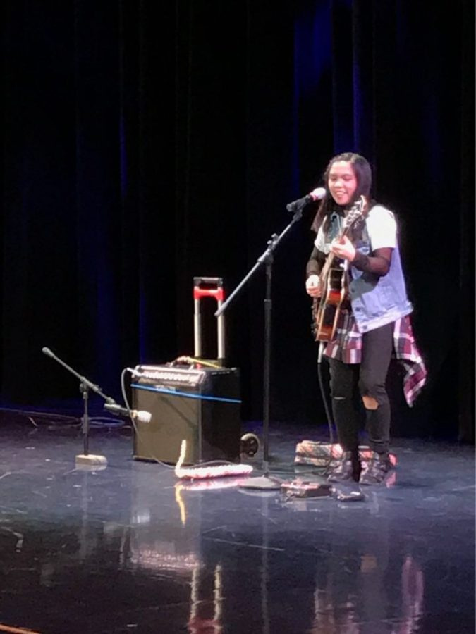 Francesca Castro, senior, performing at the talent show. Castro won first place by playing guitar, melodica, and singing Stevie Wonder's
