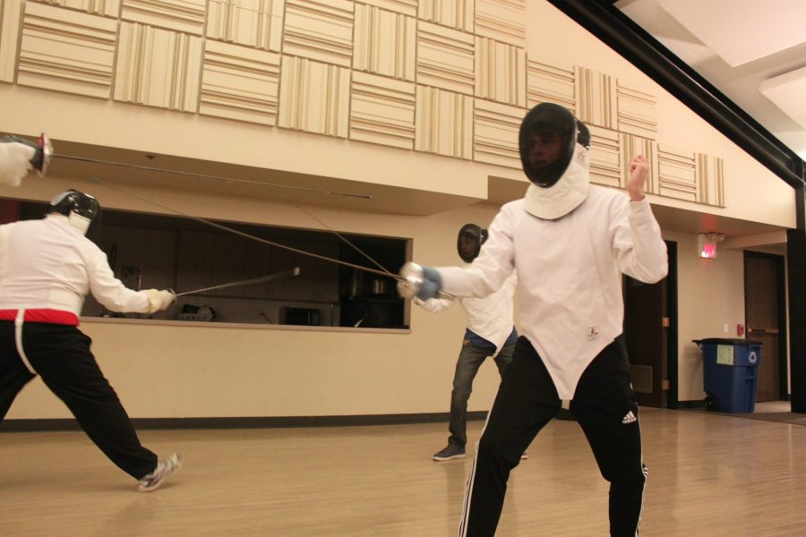 Christian Schumacher, senior fencer, fights his opponent during a class at the Barrington Fencing Club.