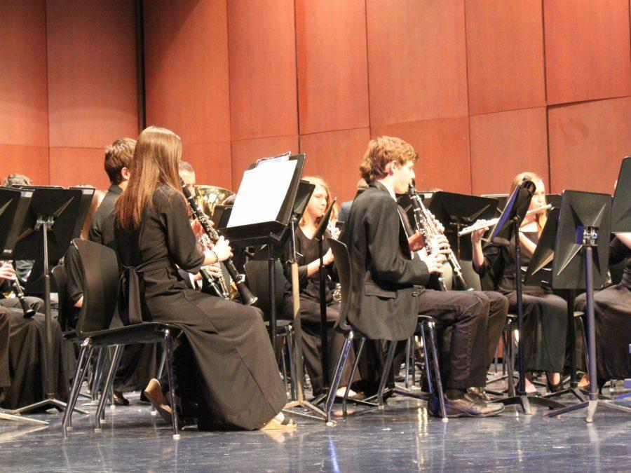 Band members perform at their concert on March 9 to show their improvement and hard work.