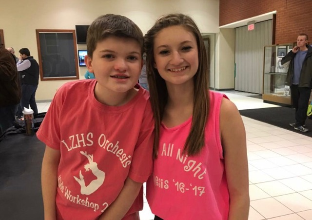 Lacey Ketcham, junior, stands with her 7th grade brother, Adam who has autism.