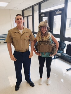 Pete Baldaccini, 2016 graduate, and his sister, Sedona Baldaccini, senior, pose with his US Marine Corps gear while on a visit to recruit LZHS students for the Marines.