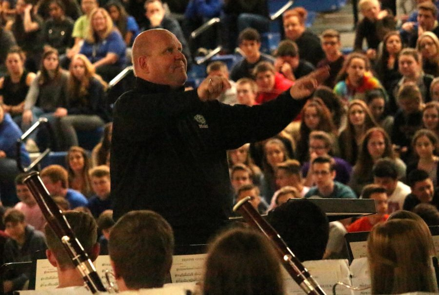 Kent Nightlinger, principal, directs the wind ensemble in his final spring assembly.