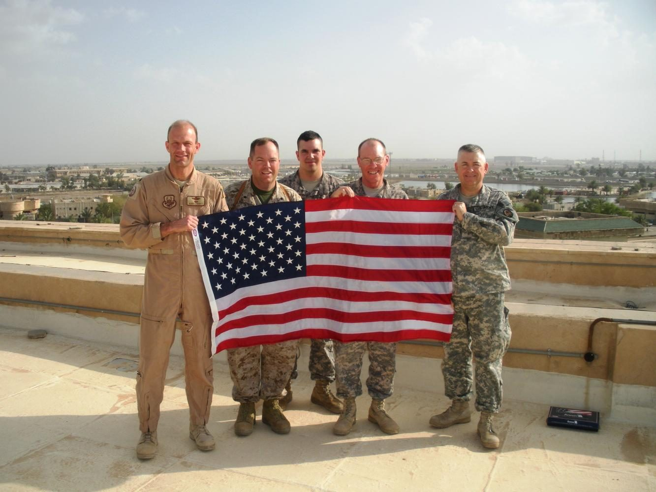 Bob Knuth stands with his fellow soldiers and the United States Flag. Knuth spent 37 years in the US Army.
