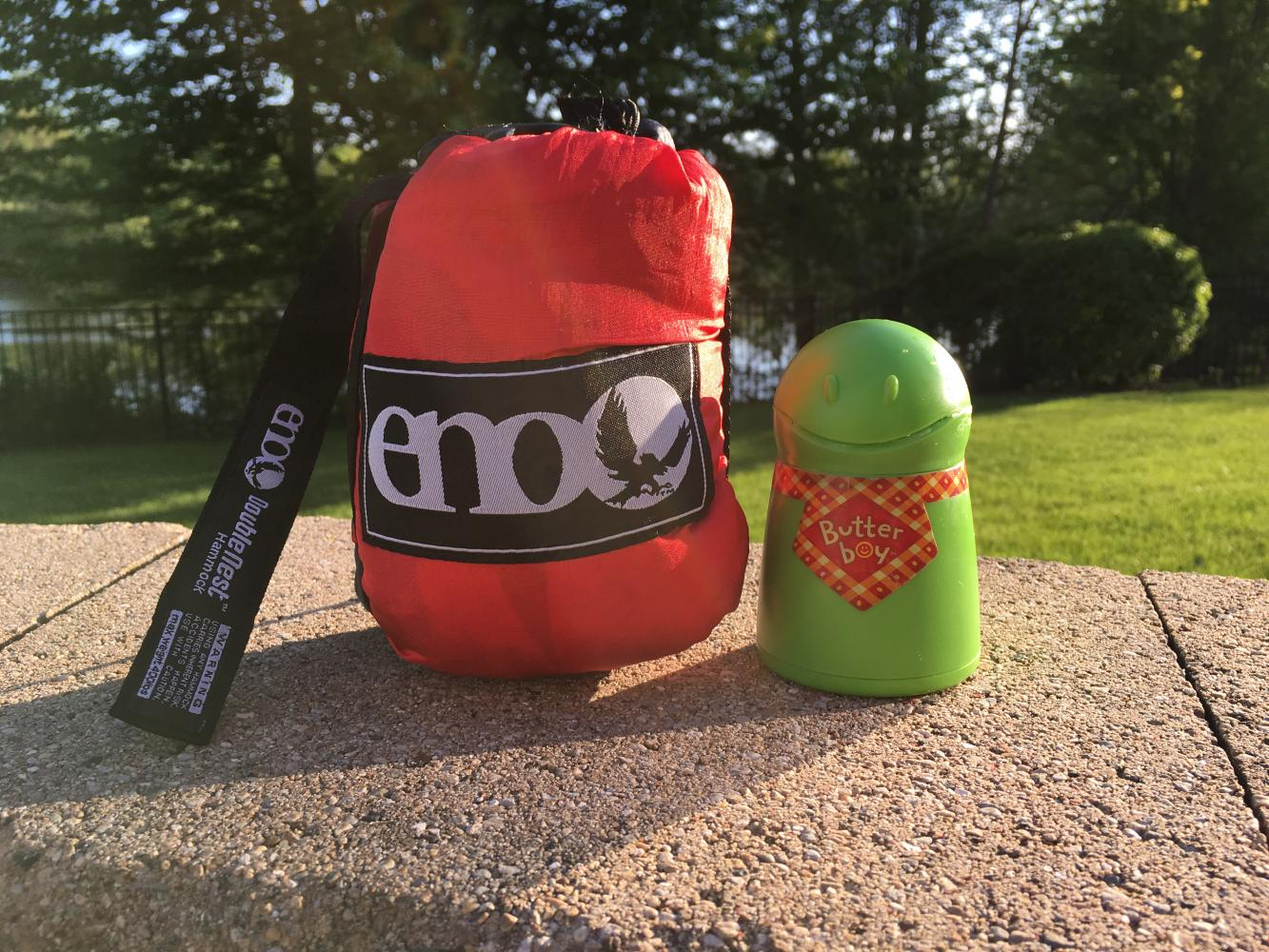 The ENO Hammock and Butter Boy are two simple ways to make a more relaxing summer. The ENO hammock costs approximately $100, and the Butter Boy is $8