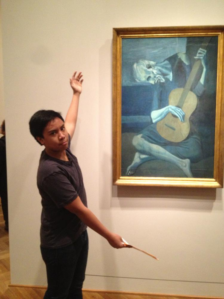 Julian Mauleon poses in front Pablo Picasso's The Old Guitarist from last year's Spanish field trip. The students will be able to see many different forms of art and see the Spanish culture's influence.