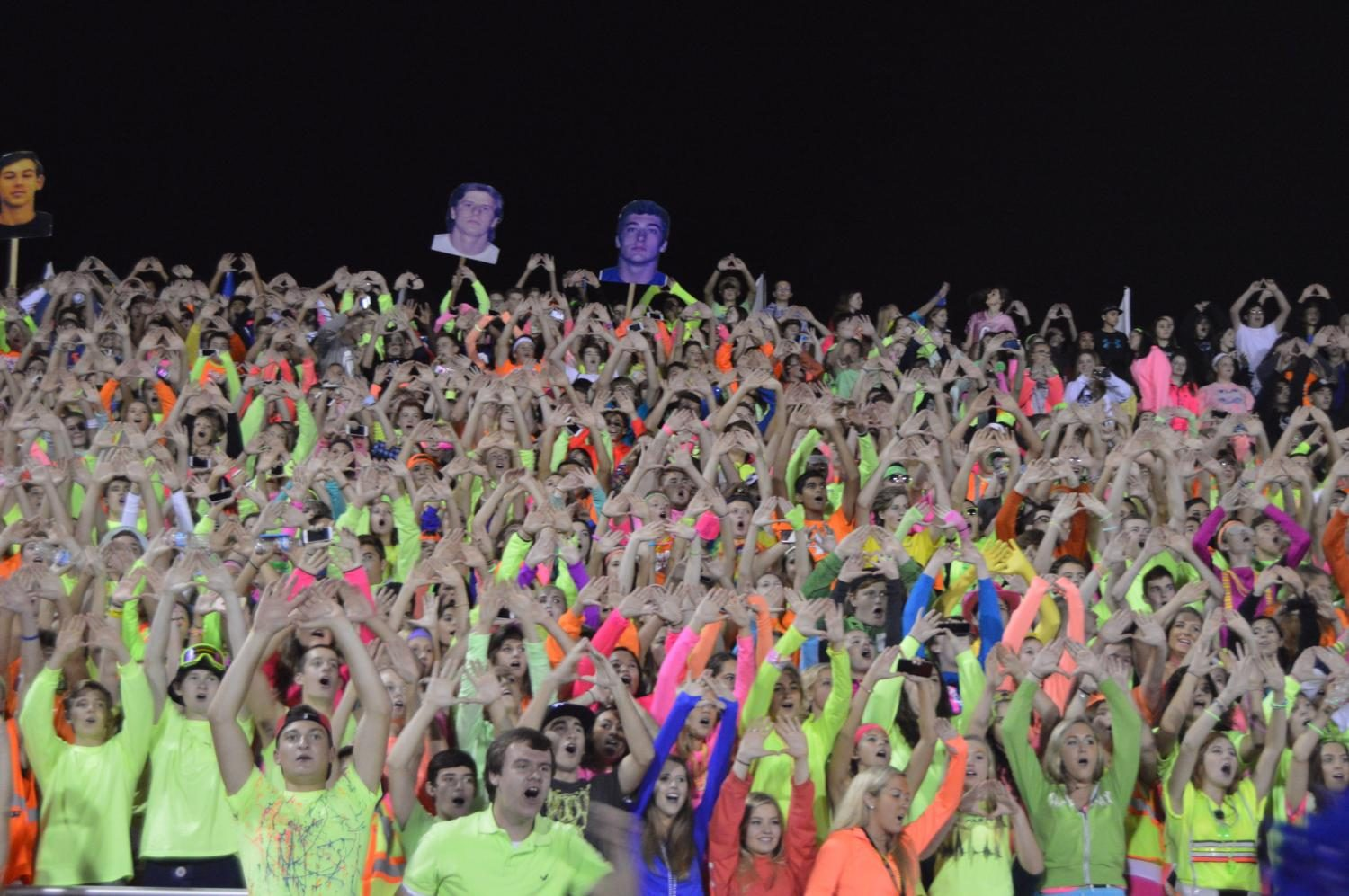 The+Student+Section+cheers+during+a+kickoff+against+Warren.+This+year%27s+Student+Section+had+one+leader+and+several+helpers%2C+but+future+Sections+will+have+approximately+ten+spread+out+over+a+greater+number+of+sports+and+activities.