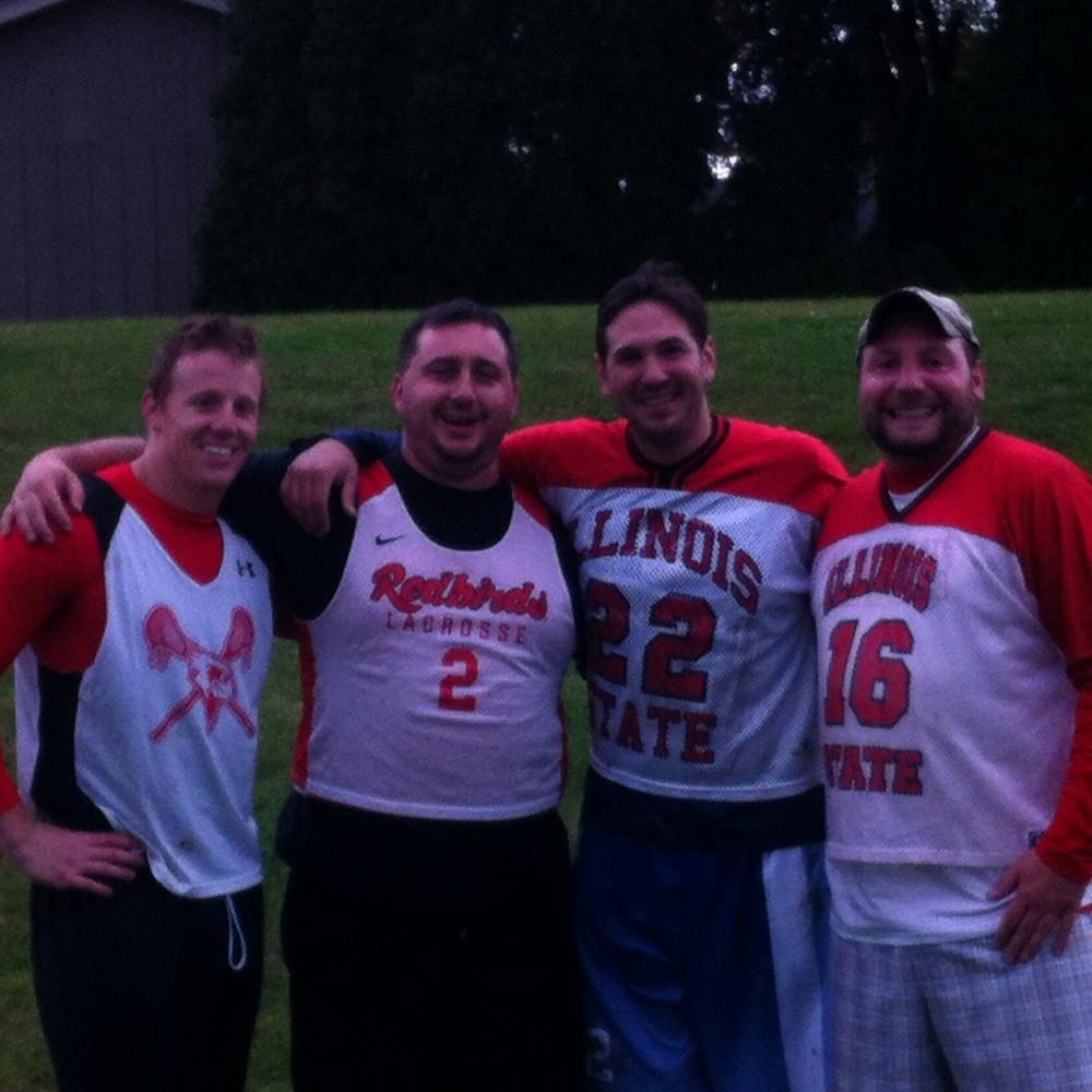 (From left to right: Former LZHS coach Tim Holden, LZHS Head coach Mike Sutton, former LZHS coach Adam Silverstein,  LZHS Asst. coach Chuck Vozas) all dressed in Illinois State lacrosse gear.