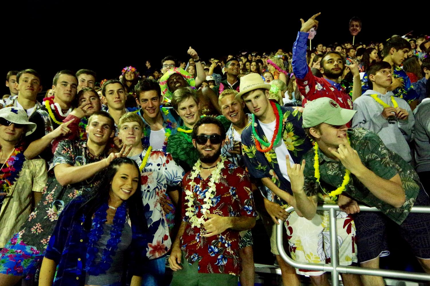 Student Section leaders Jordan Dickson, Will Ergastolo, and Ronan Kennedy join students in the stands to support the Bears at their football game.