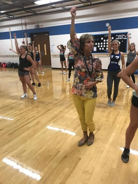 Teri Johlie, poms coach,  instructs her team on the next routine at practice.