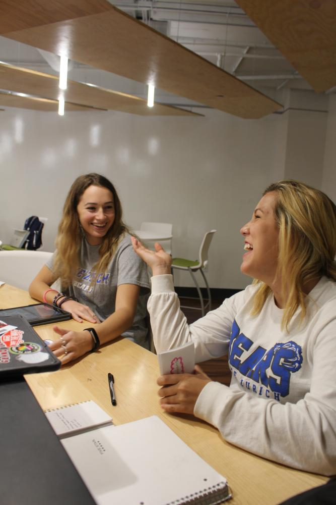 Leah Cunningham, freshman, has a few laughs with friend Lara Cardona, freshman, in Studio C during their study hall.