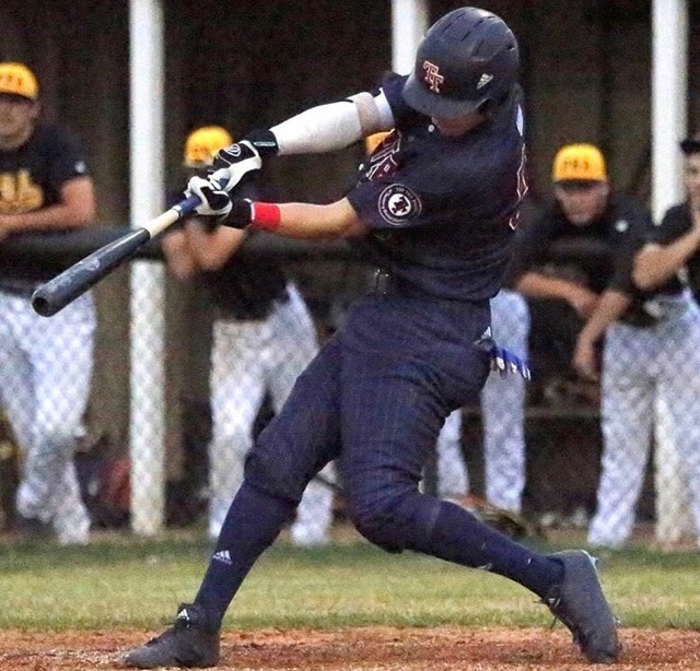 Tyler Snep playing baseball in a game with his travel team, Top Tier.  Snep committed to Iowa through Top Tier.