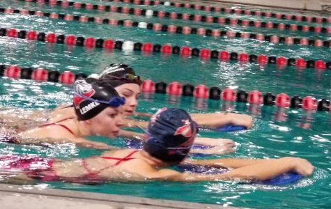 Now practicing alone, swim team heads into first tournament