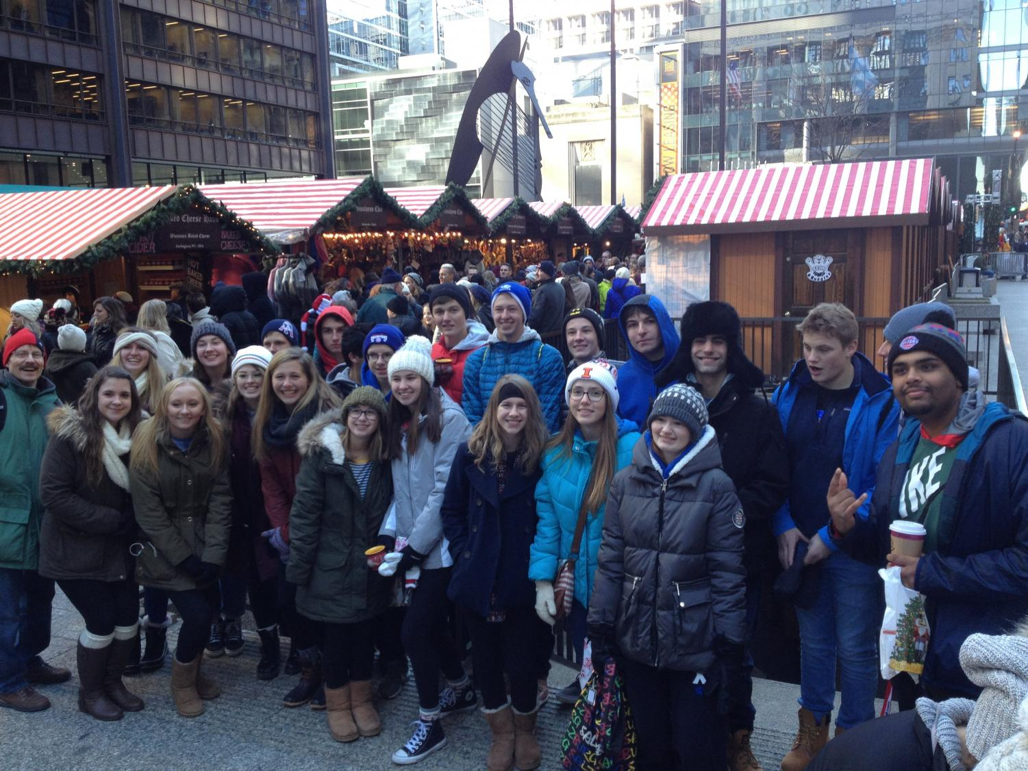 German IV students pose in front of the German market during their Saturday field trip. The trip showed German Christmastime traditions to Lake Zurich students.