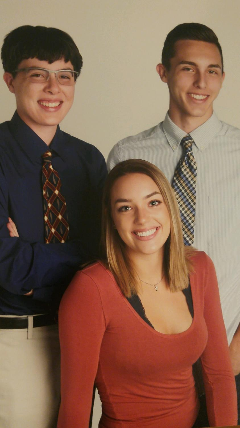 Kyle Grenier (left), Olivia Grenier (middle), and Steven Grenier (right), are senior triplets. While they are siblings, these three students could not be more different.