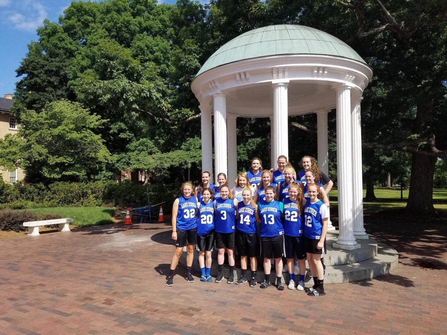 The varsity girls basketball team stands in front of the chapel at the University of North Carolina at Chapel Hill. The team traveled there for their summer camp this past summer in order to practice and increase their skills together.