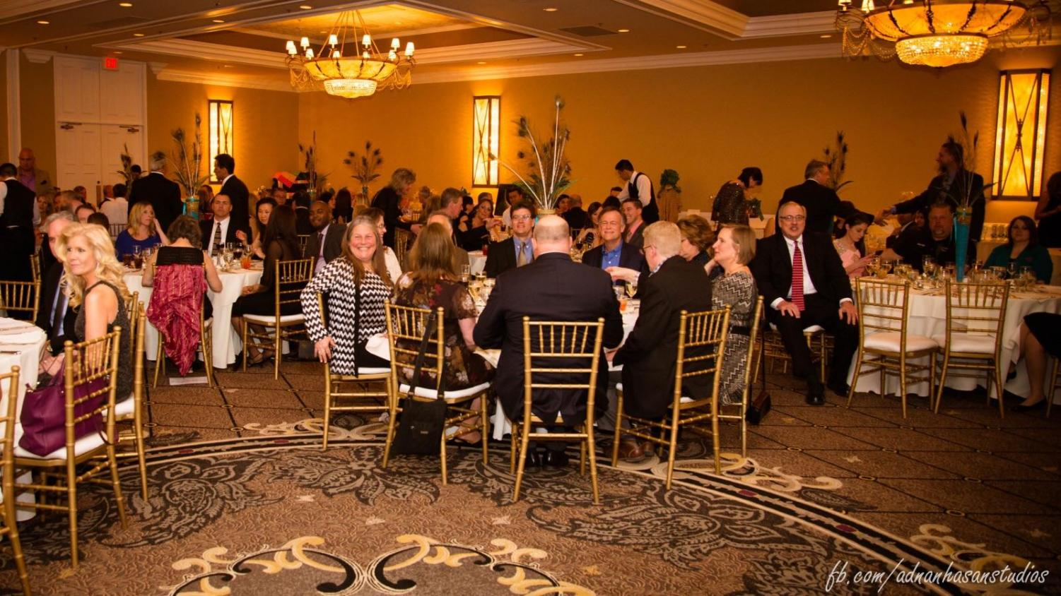 Adults converse during dinner at last year's District 95 Education Foundation Gala. This year's event is Oscar-themed and will take place in early March.