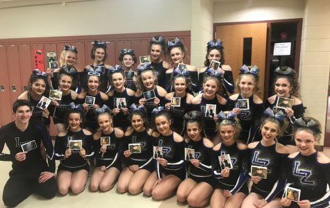 Cheer team helps aspiring cheerleaders through clinics