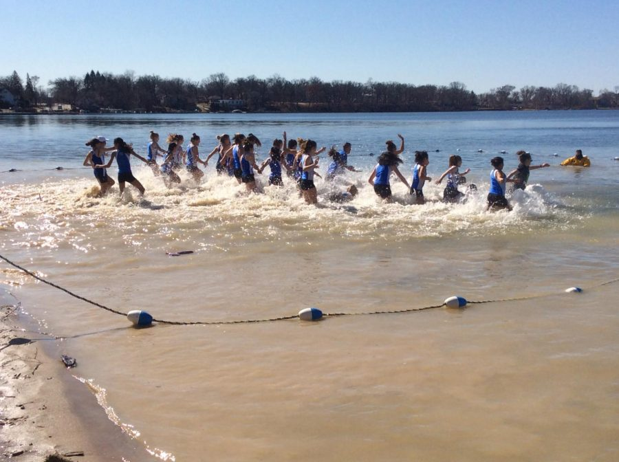 The+girls%27+track+and+field+team+participated+in+the+Polar+Plunge%2C+among+other+teams%2C+community+groups%2C+and+families.+The+event+raised+money+for+families+affected+by+cancer.