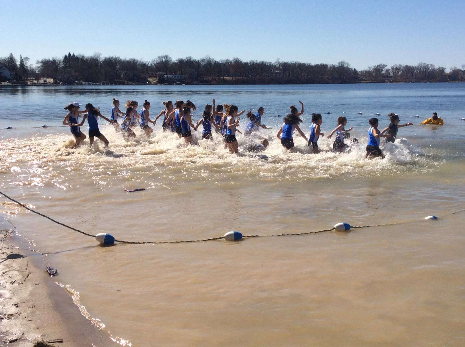 The girls' track and field team participated in the Polar Plunge, among other teams, community groups, and families. The event raised money for families affected by cancer.
