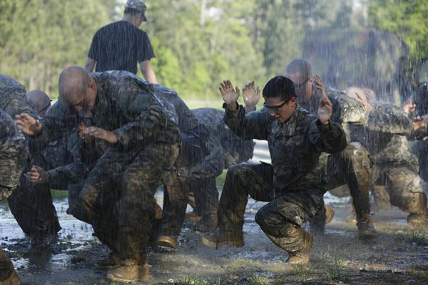 Soldiers training to be military work through the rain to complete their task. This is just some of the intense training Peter Tobin, senior, will have to face through his journey into the marines.