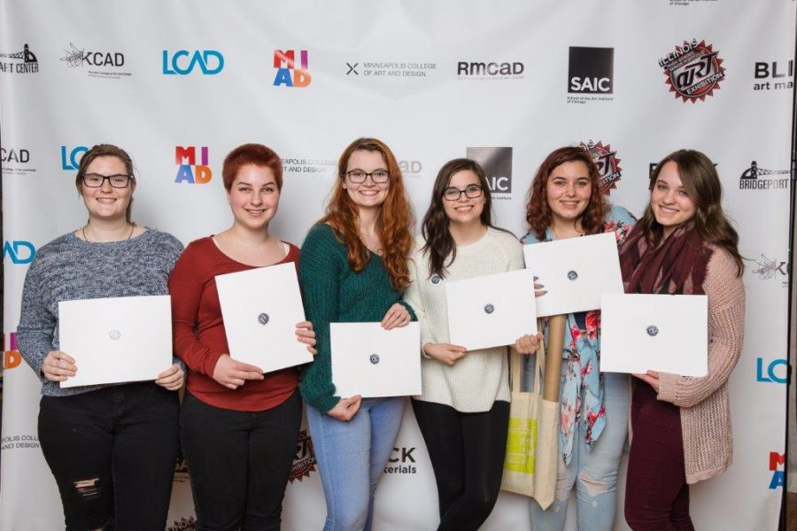 Seniors Bailey Recktenwald, Grace Bejnarowicz, Chloe Fletcher, Shayna Soloway, Gillian Teichman, and Lara Zuk stand with thier awards from the annual senior Art Show. Together, the senior girls were awarded almost one million dollars in scholarship money for different art schools around the nation.