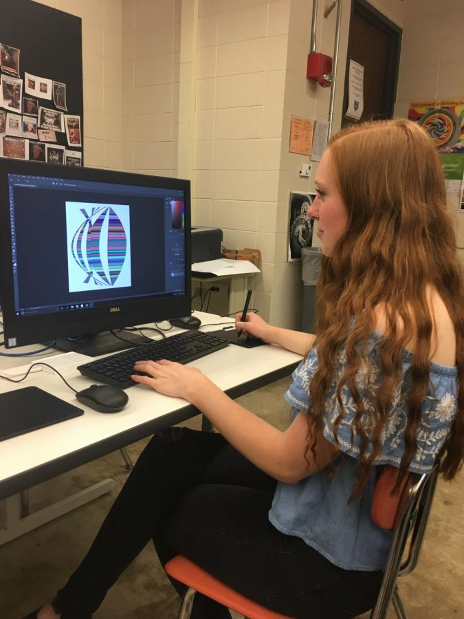 McKenna works at her computer in photoshop. She loads the pictures she takes into photoshop and then edits them to create her pieces.