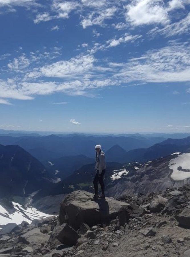 Kaia Rytel, sophomore, poses on Mt. Rainier in Washington. Rytel believes vacations like these really open her eyes to how large the world actually is.