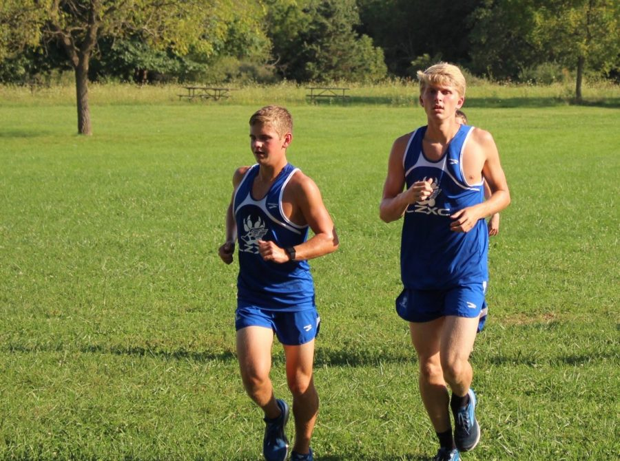Two runners of the boys cross country team finishing their warmup. Members like these are going to have to work really hard considering the seniors are gone.